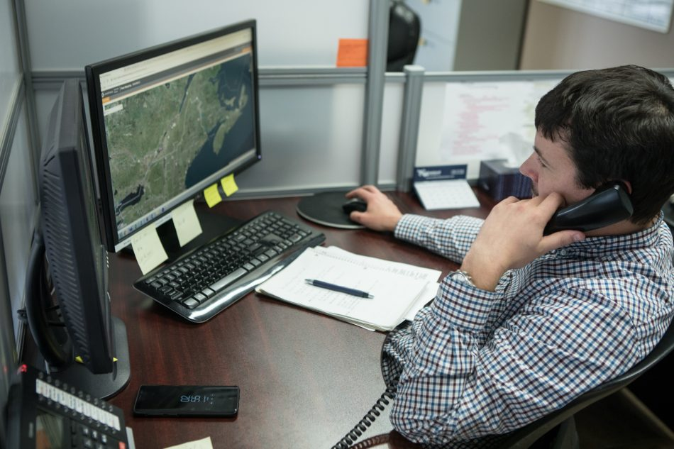 Professional Carriers staff member tracks truck locations across North America