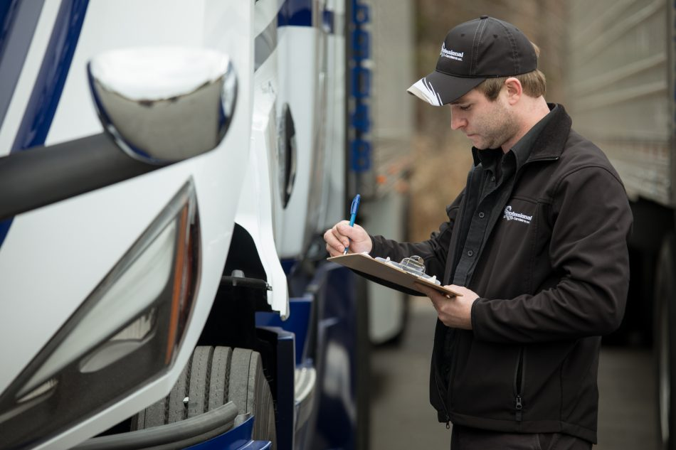 Professional Carriers driver inspects truck